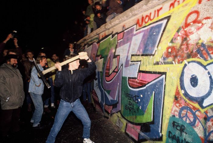 a-man-attacks-the-berlin-wall-with-a-pickaxe-on-the-night-of-november-9th--1989-527012766-594758705f9b58d58ae778c6